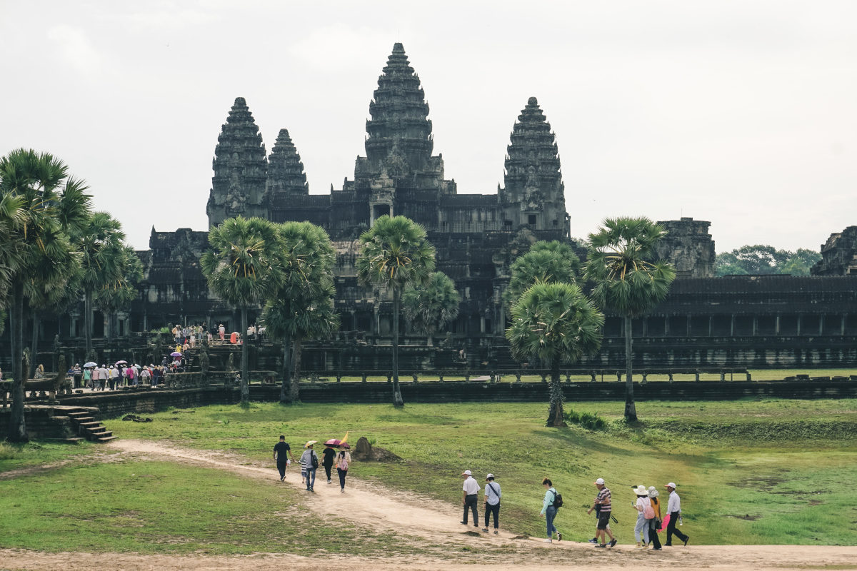 huge Asian temple in Cambodia with tourists in front