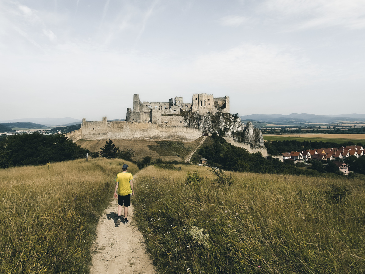 Tourist at viewpoint of Beckov Castle