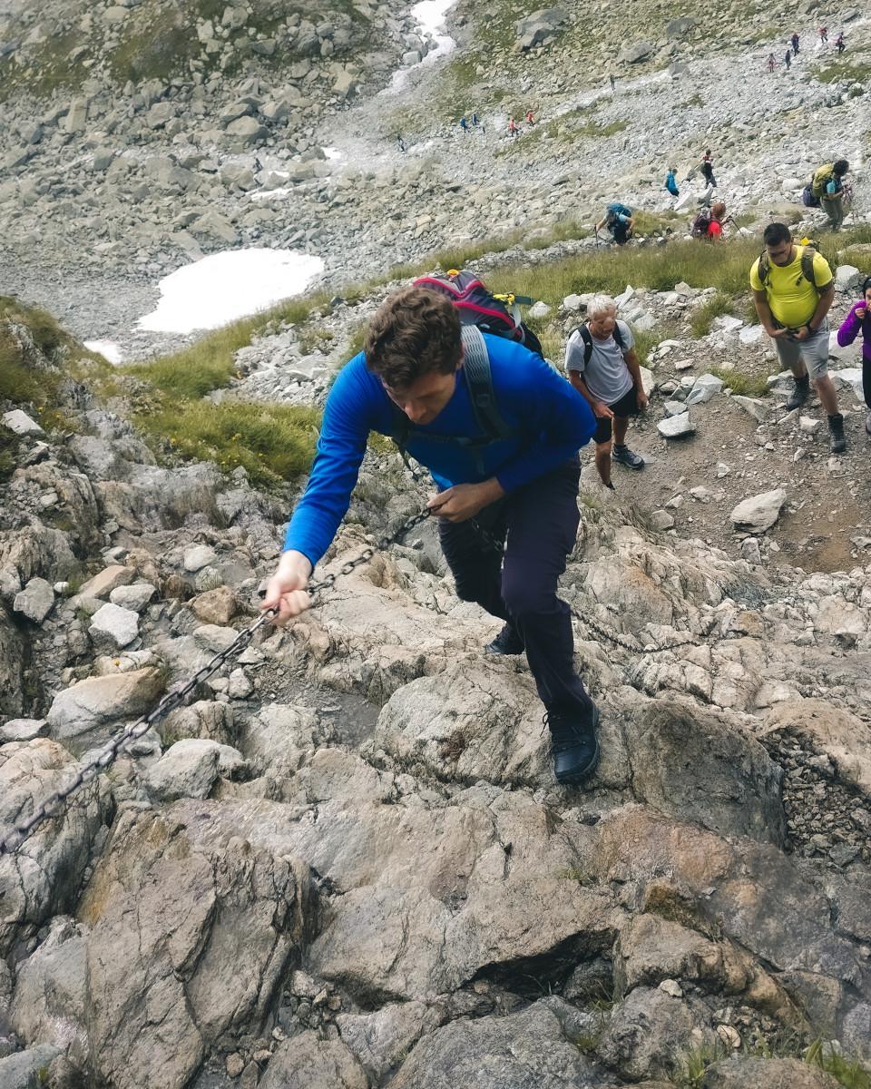 Hiker climbs on rocks