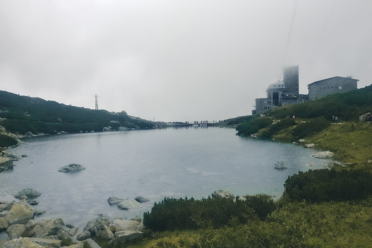 Rocky lake in fog
