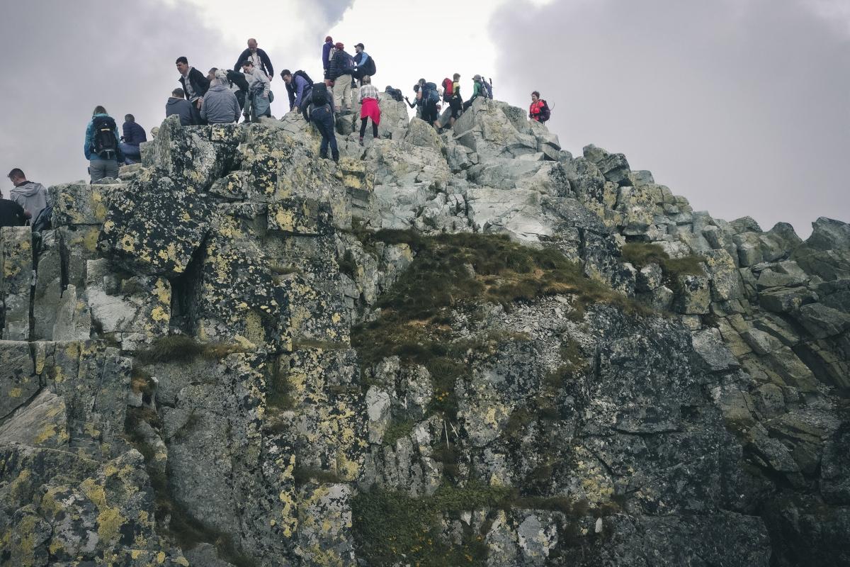 Tourists on the summit of Rysy