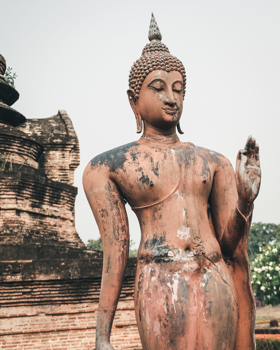 Holy statue in front of a temple