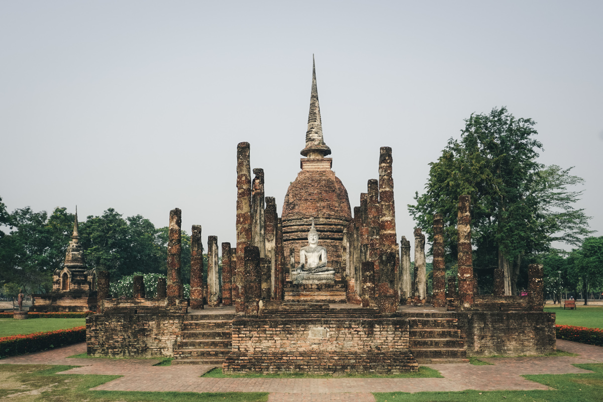 Brown temple with a white Buddha statue
