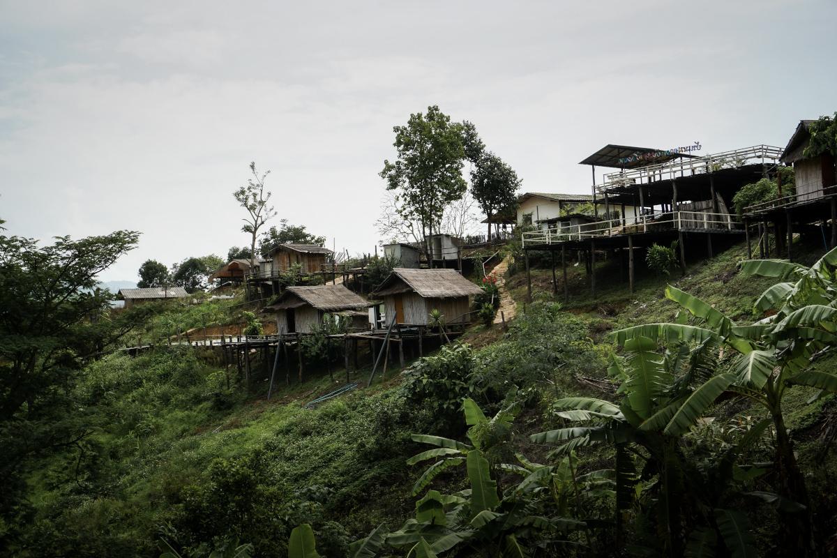 Wooden huts on stilts on the mountainside