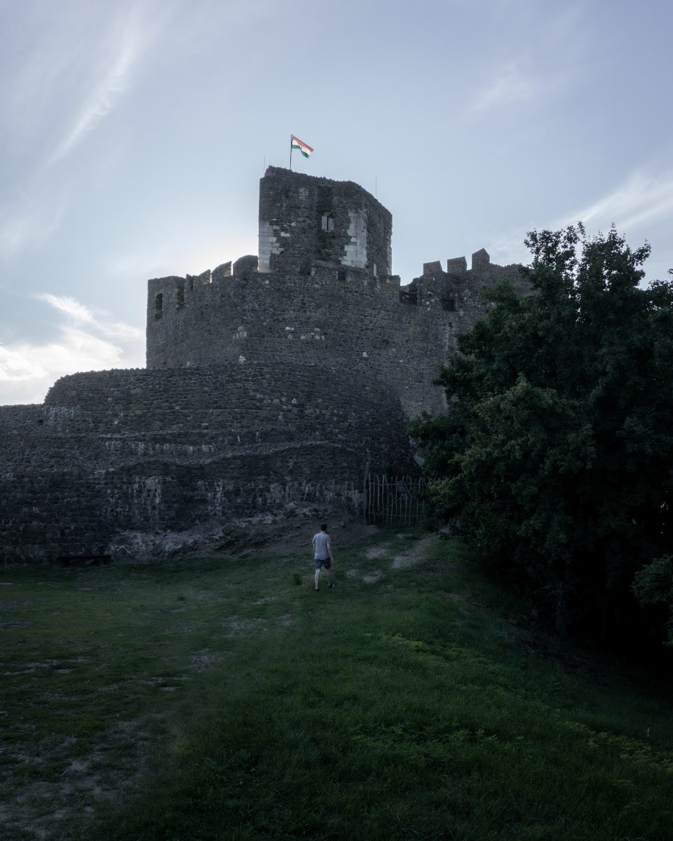 Old castle in a Hungarian village in the evening sun