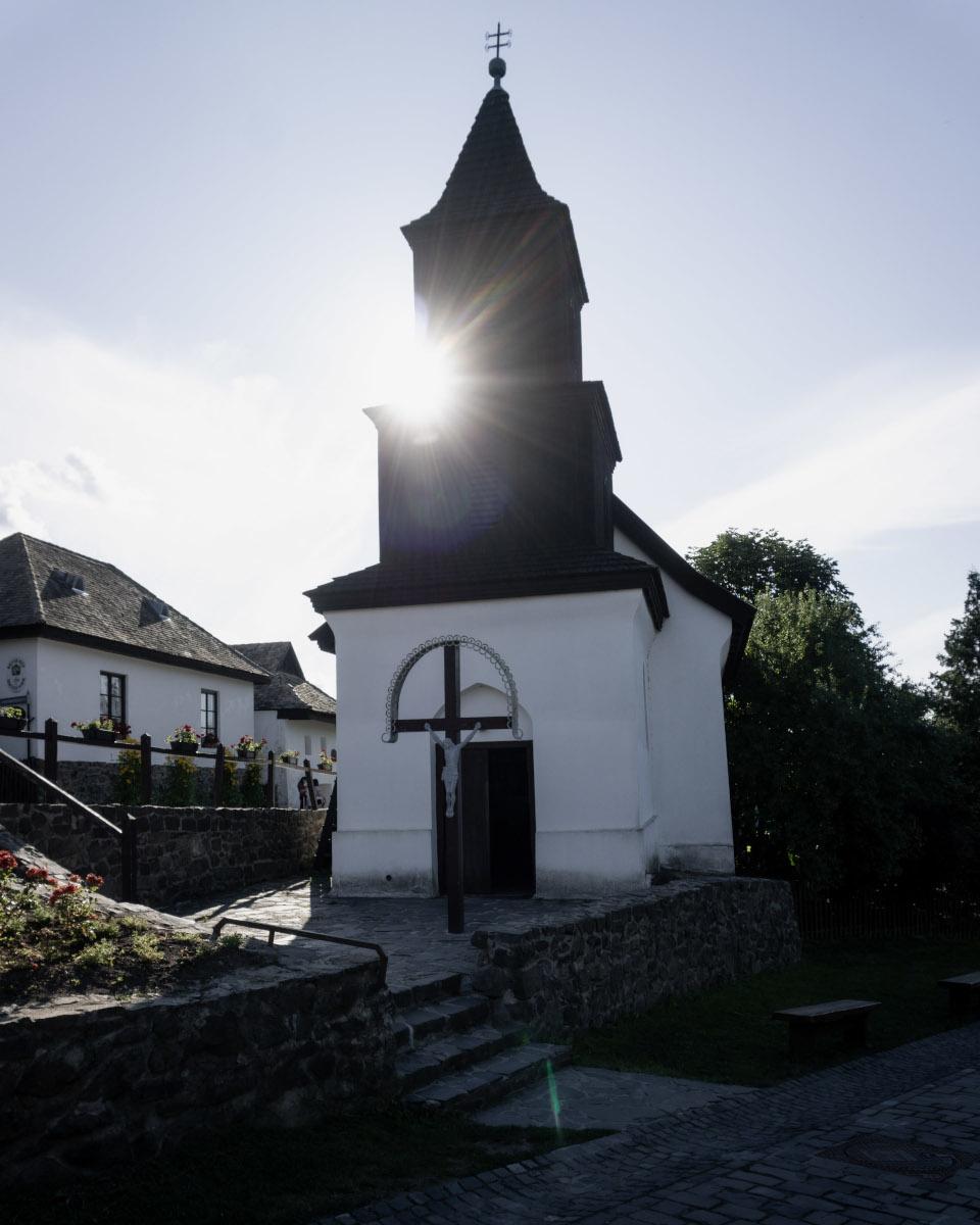 Sun rays behind a white church