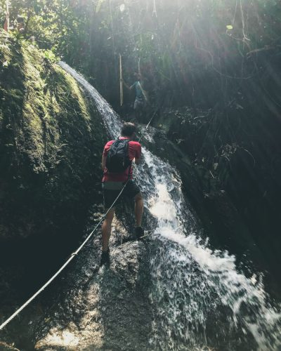 Adventure hike in waterfall